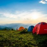 Image of Photo of Pitched Dome Tents Overlooking Mountain Ranges