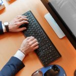Image of Person Typing on Computer Keyboard