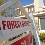 Image of house and signage foreclosure