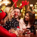 Image of Group Of Friends Enjoying Christmas Drinks In Bar