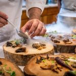 Image of Chef Preparing Vegetable Dish on Tree Slab