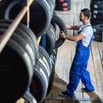 Image of a Man and Many Tire